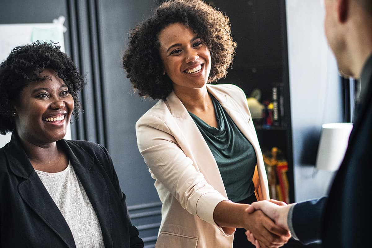 Women shaking hands with lender
